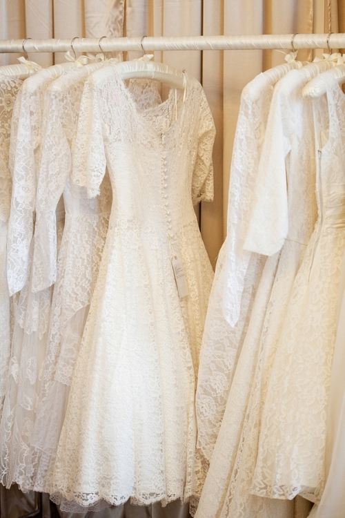 Wedding dresses hanging up on a rail