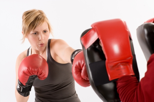 Woman boxing and exercising. Boxfit, Boxercise.